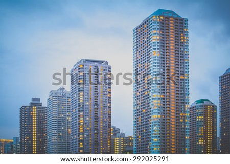 The high rise building in downtown at night - stock photo