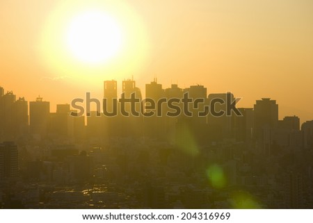 The High-Rise Building In Shinjuku And A Sun - stock photo