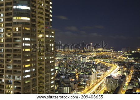 The High-Risen Apartment And The Scene Of The Night Street - stock photo