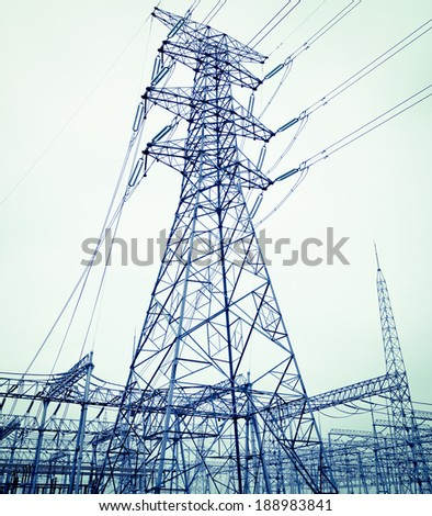The high-voltage power transmission towers - stock photo