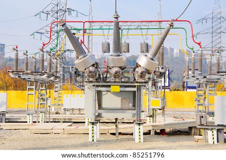 The high-voltage transformer at power plant - stock photo