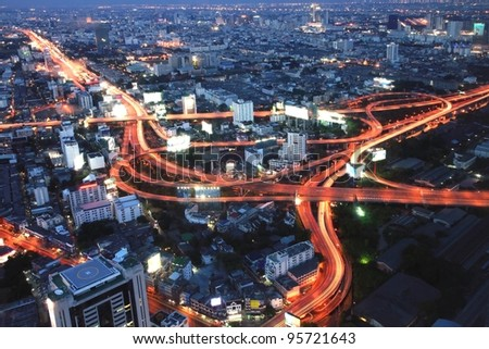 The highest Aerial view of Bangkok Highway at Dusk in Thailand - stock photo