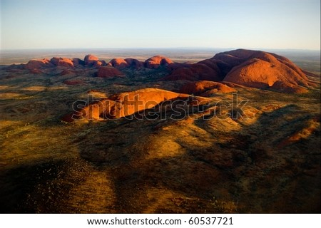 The highest monolith, Mount Olga in brightly red color of the coming sun. - stock photo