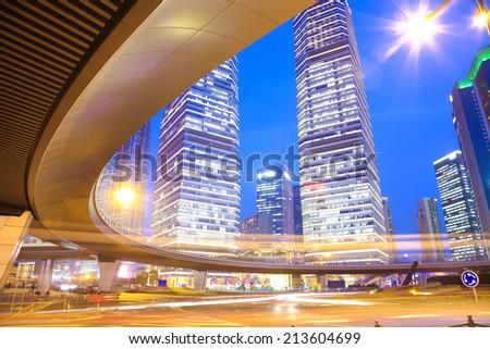 The highway bridge car light trails of shanghai city modern office buildings - stock photo