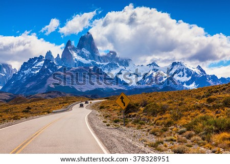 The highway leads to the snow-capped peaks of Mount Fitzroy. On the road going two jeeps - stock photo