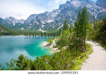 The hiking trail around Lake Braies in the Dolomites , Sudtirol,Italy - stock photo