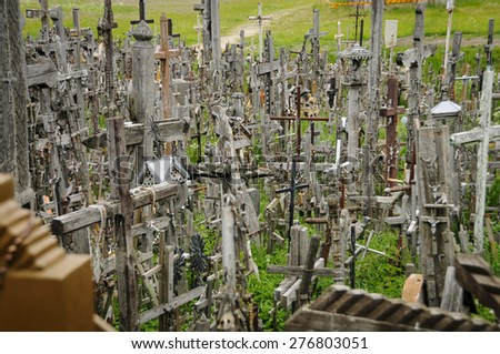 The hill of the Crosses in Lithuania, one of the most important pilgrimage sights of the region and a national monument commemorating Soviet oppression. - stock photo