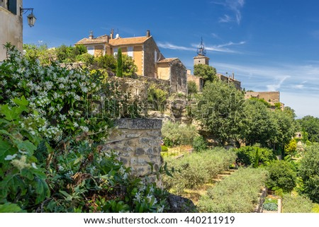 The hill top village of Menerbes in the Luberon Provence - stock photo