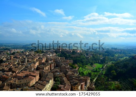The Hill town of Siena.Italy as seen from atop of the tower in Il Campo, on the main square. - stock photo