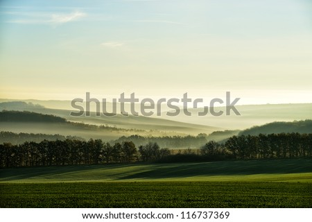 The hills in the fog. Morning landscape - stock photo