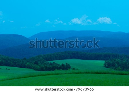 The hills of Western Pennsylvania with a welcoming yet ominous blue sky. Right outside of Kentuck Knob - stock photo