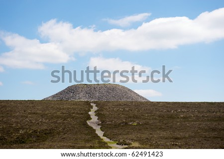 The hilltop cairn at the summit of Knocknarea, Sligo, Ireland - stock photo