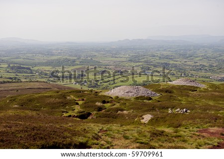 The hilltop Carrowkeel passage tombs in a view from above looking west in Summer - stock photo