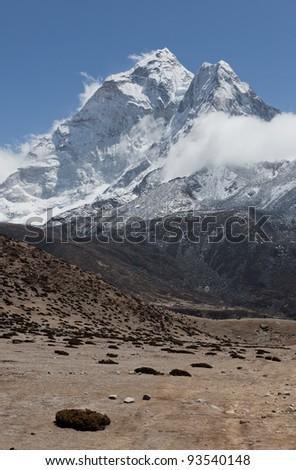 The Himalaya peak Ama Dablam (6814 m) - Mt. Everest region, Nepal - stock photo