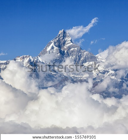 The himalayan peak Machhapuchre from the south (view from the motor hang-gliding) - Nepal - stock photo