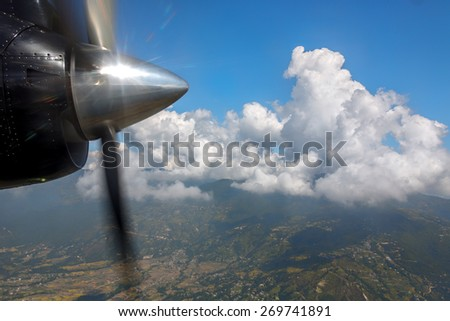 The Himalayas under the wing of the small airplane - Nepal