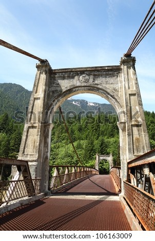 The historic Alexandra Bridge is a suspension bridge crossing the Fraser River. It was built in 1926 to provide a crossing for the Cariboo Road and later the Fraser Canyon Highway. - stock photo