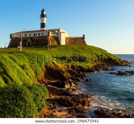The historic architecture of Farol da Barra lighthouse in Salvador, Bahia, Brazil on a sunny summer day. - stock photo