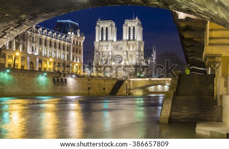 The historic Catholic cathedral Notre Dame is considered as one of the finest examples of French Gothic architecture, and it is among the largest and most well-known church buildings in the world. - stock photo