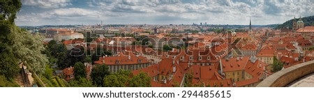 The historic center of Prague, ancient architecture, and cultural heritage/Panorama of Prague with Prague Castle, red roofs of Prague