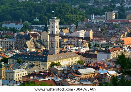 The historic city center of Lviv, old houses in the old town, Tower of City Hall on the Market Square. Lvov, Ukraine - stock photo