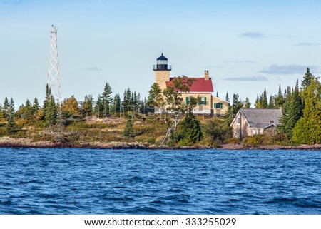 The historic Copper Harbor LIghthouse stands on the Lake Superior Coast of Upper Peninsula Michigan's Keweenaw Peninsula. - stock photo