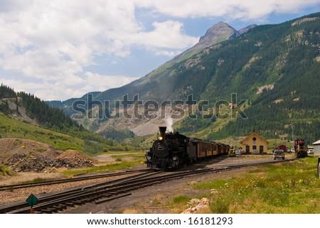 The historic narrow gauge Durango-Silverton steam locomotive approaches Silverton, Colorado. - stock photo