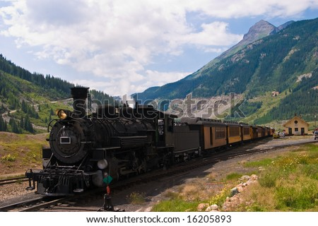 The historic narrow gauge Durango-Silverton steam locomotive approaches Silverton, Colorado. - stock photo
