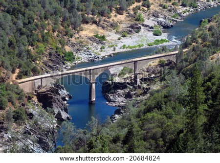 The historic No Hands Bridge spanning the American River in Auburn California. Built in 1912 and listed on the National Register of Historic Places.