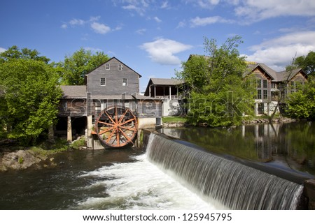 The historic Old Mill in Pigeon Forge was built in 1830 and remains the premier attraction in this town in the Smoky Mountains. - stock photo