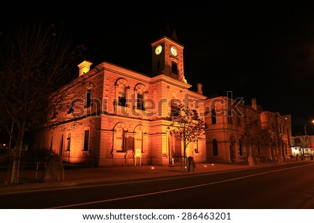 The historic old Town Hall (built 1882) in Mount Gambier, South Australia, lit up at night.  - stock photo