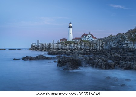 The historic Portland Light at Cape Elizabeth, Maine marks the primary shipping channel for Portland Harbor, in Casco Bay in the Gulf of Maine. Built in 1791 it is the oldest lighthouse in Maine. - stock photo