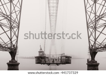 The historic transporter bridge crossing the River Usk in Newport City, south Wales.  - stock photo