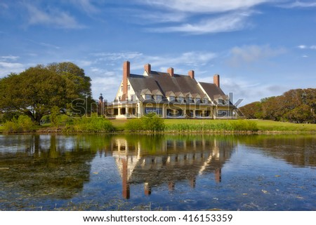 The historic Whalehead Club, built in 1920, in Corolla, North Carolina has been restored to its original grandeur. The former home is now a museum. - stock photo