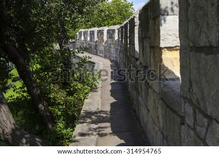 The historic York City Walls in York, England.  Since Roman times, the city of York has been defended by walls and substantial portions of these still remain today. - stock photo
