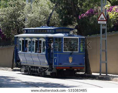 The historical blue tram carrying passengers in Barcelona, Spain, July 2016