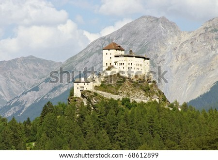 The historical castleTarasp in the Swiss Alps (Graubunden, Switzerland) - stock photo