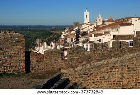 The historical hilltop fortified town of Monsaraz, Evora, viewed from the battlements of the ruined medieval castle. Alentejo Region, Portugal. - stock photo