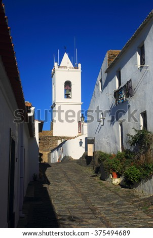 The historical hilltop fortified town of Monsaraz in the late afternoon sunshine. Evora, Alentejo Region, Portugal. - stock photo
