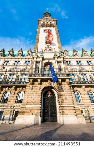 The historical townhall of Hamburg, Germany with local and European flags - stock photo