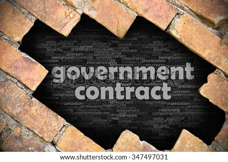 The hole in the brick wall with word government contract - stock photo