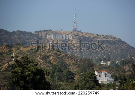 The Hollywood Sign, viewed from Hollywood Boulevard, is a landmark and American cultural icon located on Mount Lee in the Hollywood Hills in Los Angeles, California on May 18, 2014 - stock photo
