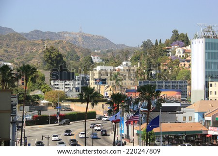 The Hollywood Sign, viewed from Hollywood Boulevard on May 19, 2014, is a landmark and American cultural icon located on Mount Lee in the Hollywood Hills in Los Angeles, California - stock photo