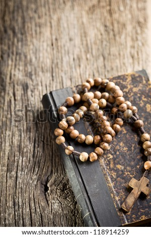 the holy bible and rosary beads - stock photo