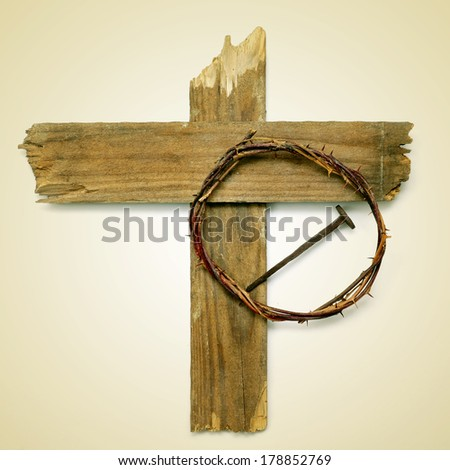 the Holy Cross, the crown of thorns and a nail depicting the passion of Jesus Christ on a beige background, with a retro effect - stock photo