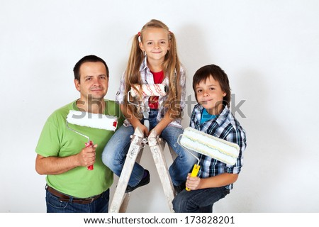 The home improvement squad - kids and their father with painting utensils - stock photo
