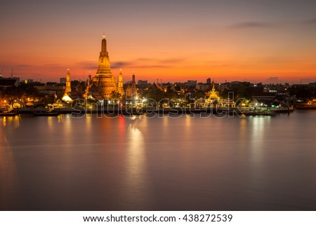 The horizontal image of view of Chao Phraya River on the opposite site of Wat Arun Temple (Temple of Dawn) just after sunset. This is one of most popular landmark of Bangkok  (postcard view). - stock photo