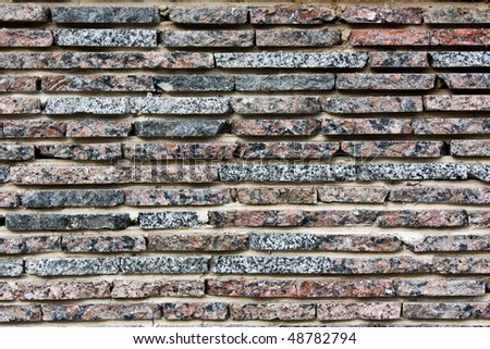 the horizontal stone wall of a nature rock - stock photo