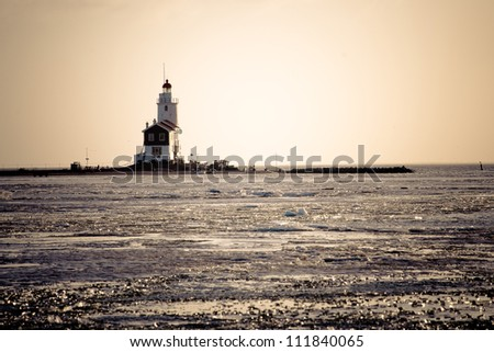 The Horse of Marken of Marken is the lighthouse. The lighthouse was designed by J. Valk and built in 1839 and stands on the eastern tip of the island. - stock photo