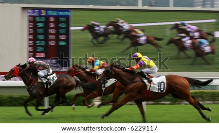 The Horse Racing at Hong Kong Jockey Club, big screen on the background. (got some noise due to high ISO and slight blurry for motion effect)